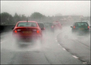 Wet roads, cars and driving- hydroplaning danger